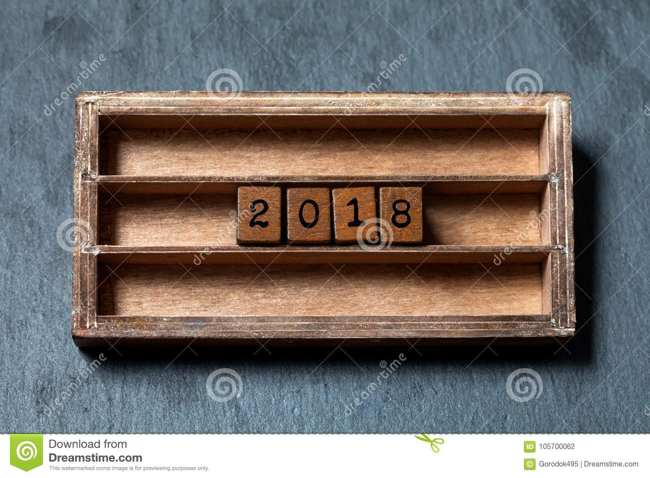 2018 year greeting card invitation poster. Vintage box, wooden cubes with old style letters. Gray stone textured