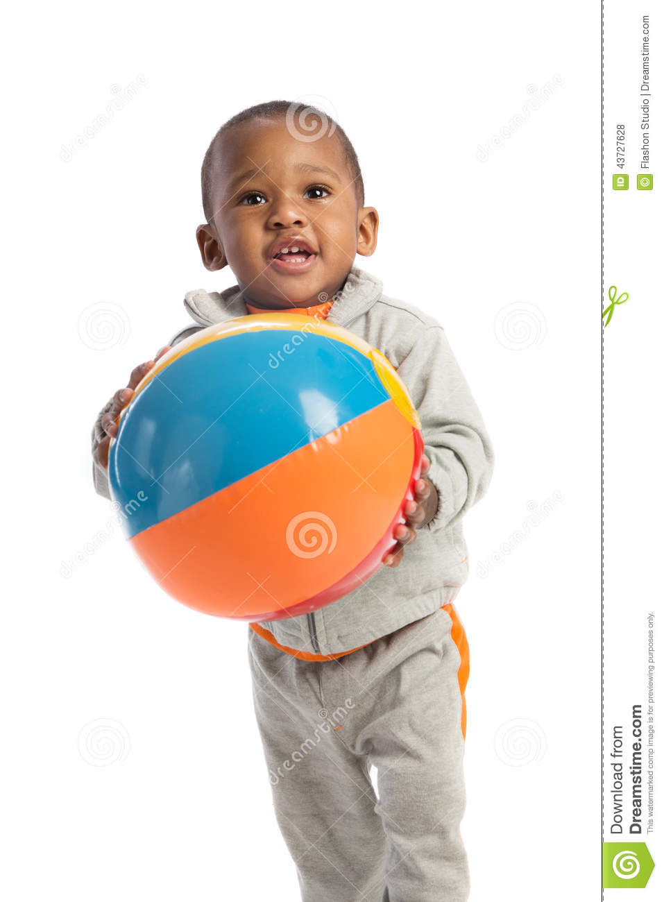1 Year Old Baby Boy Standing Holding A Beach Ball Stock