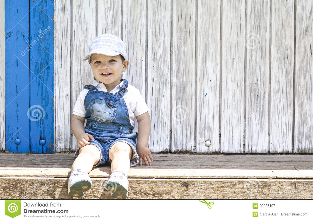 d4b7a2e5afe79 2 Year-old Boy Sitting Portrait At Wooden Beach Hut Stock Image ...