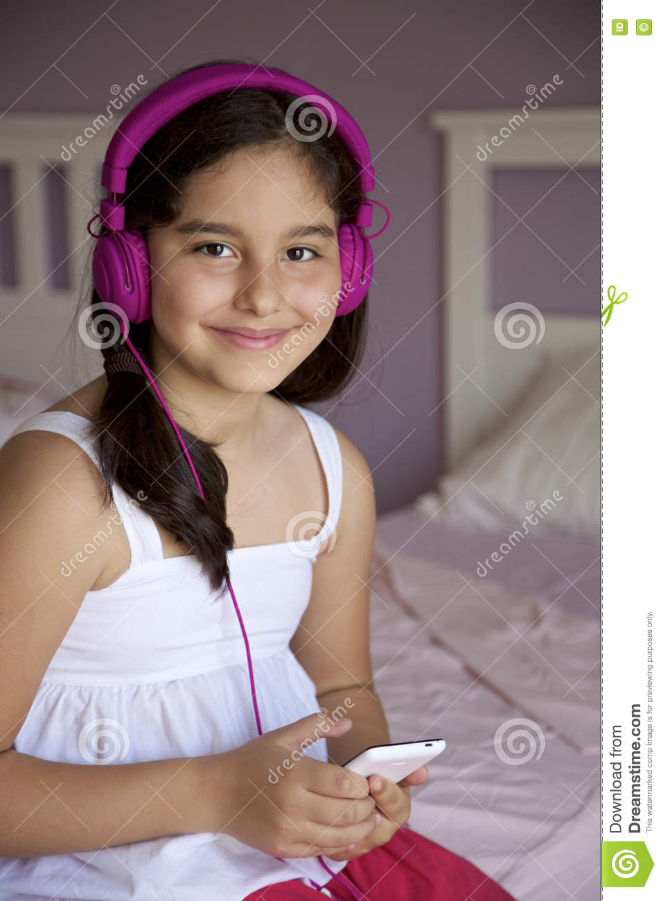 9 Year Old Girl Listening To Music Stock Photo Image