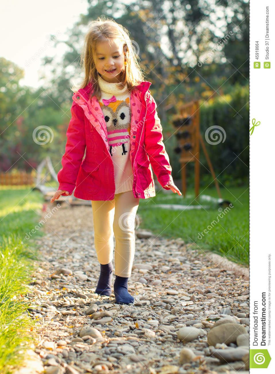 Four Year Two Year Community: 4 Year Old Girl Walking Over Pebbles Stock Photo