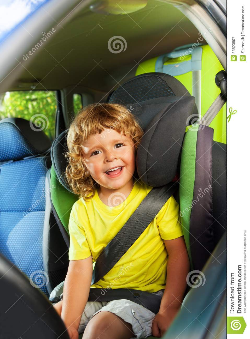 3 years old boy in the back child seat royalty free stock. Black Bedroom Furniture Sets. Home Design Ideas
