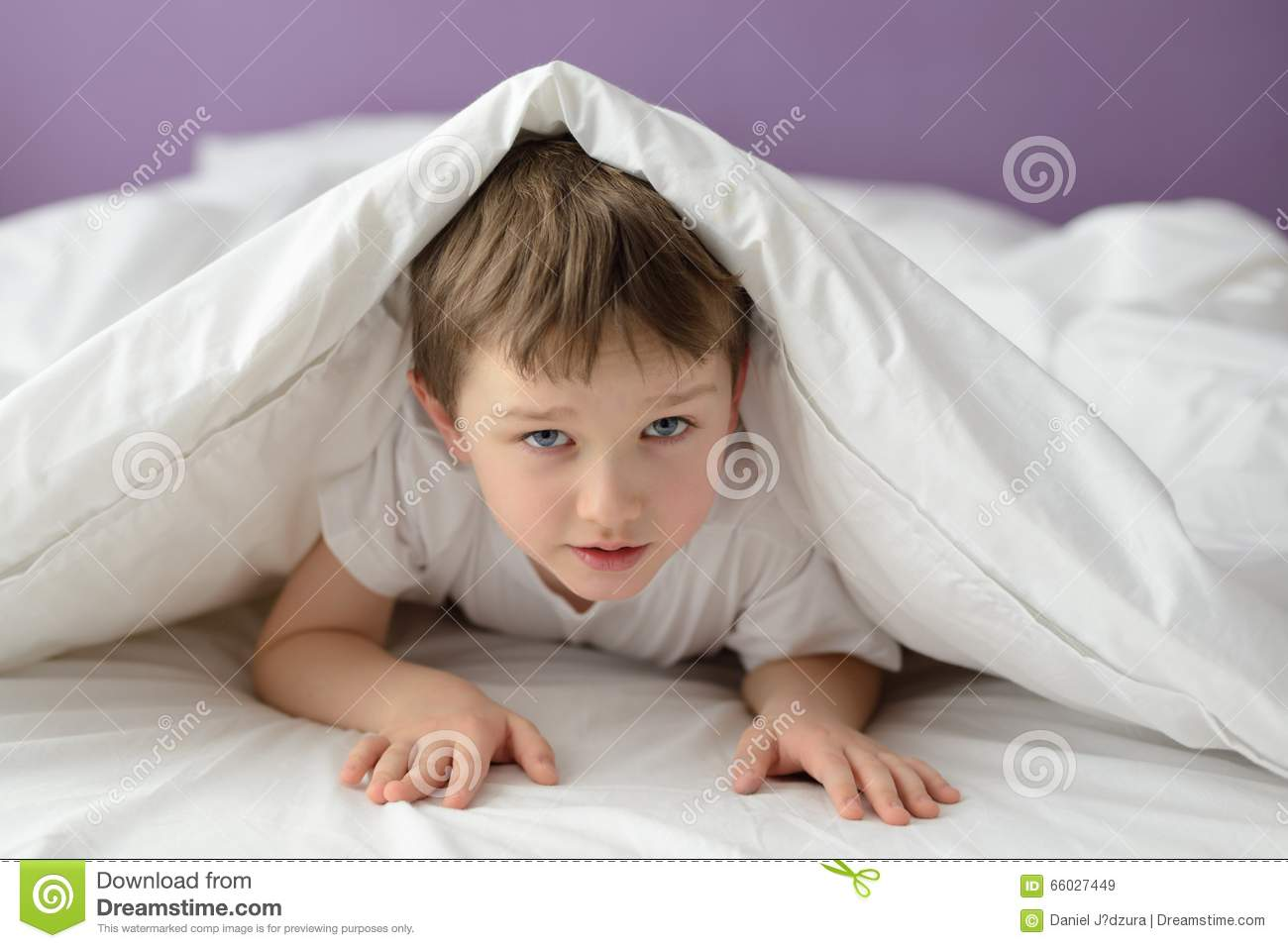 7 years old boy hiding in bed under a white blanket or for Beds for 13 year olds
