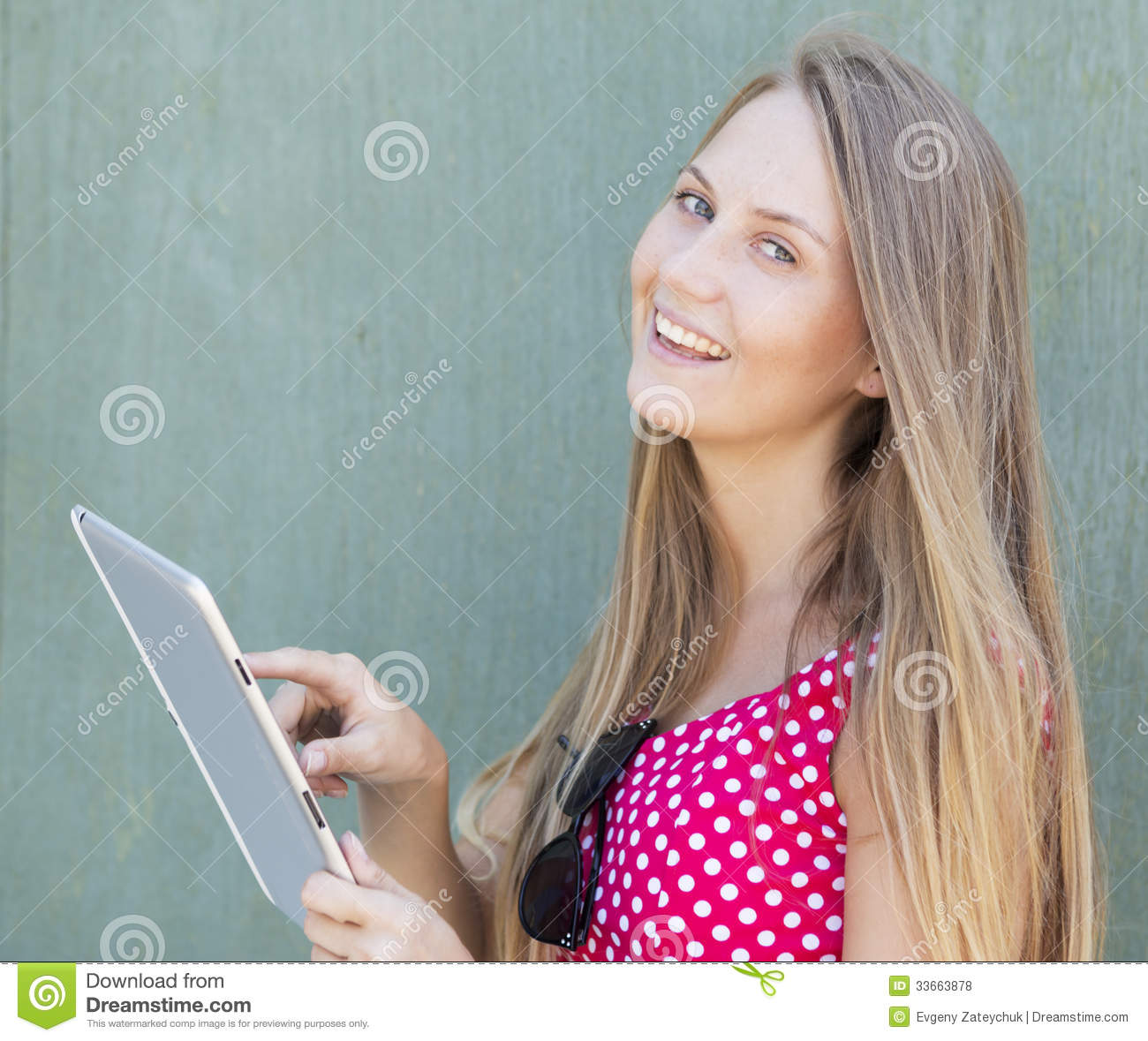 20 Years Old Girl Touching The Tablet Computer And Smiling