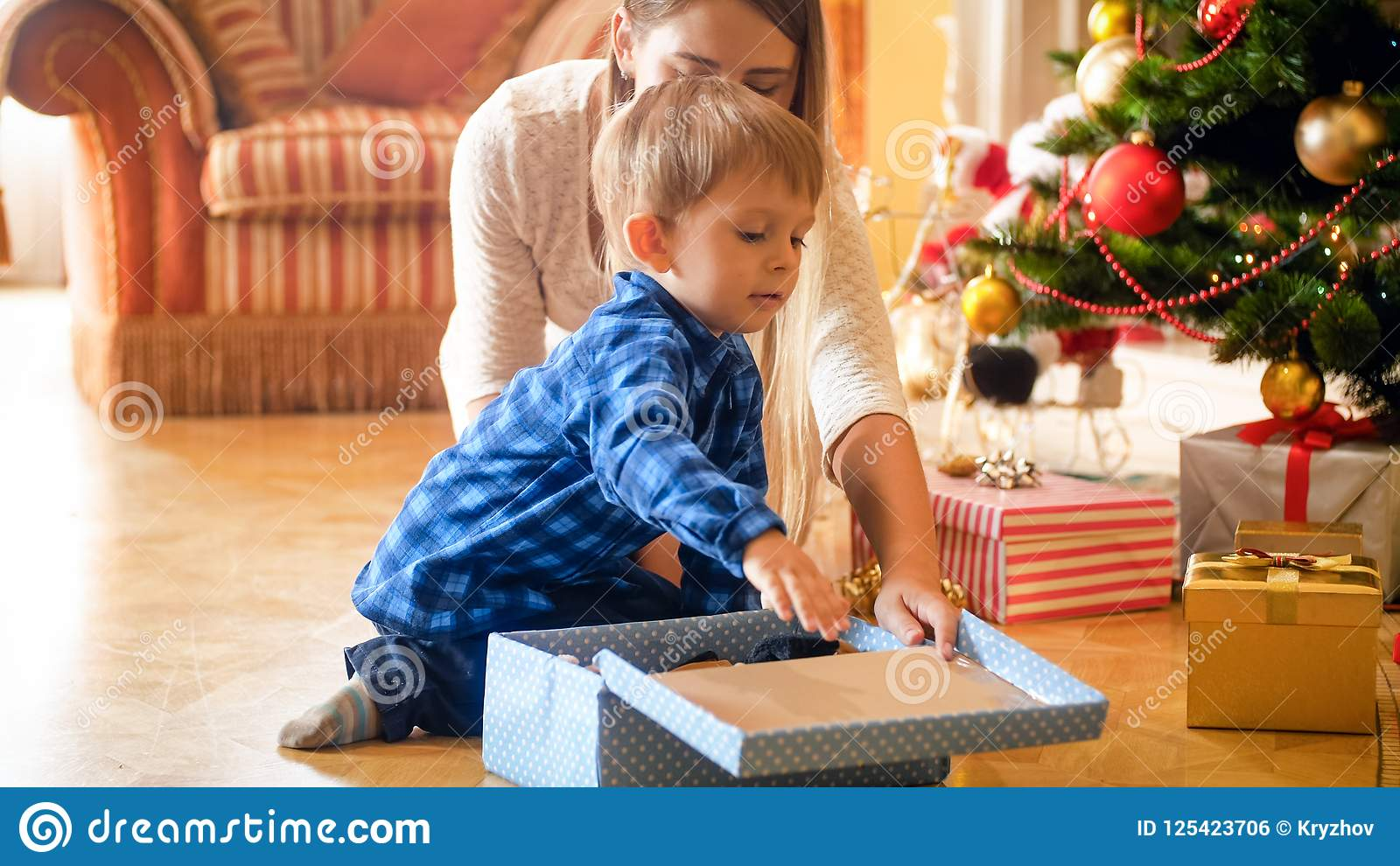 3 Years Old Toddler Boy Receiving CHristmas Gift Under Christmas ...