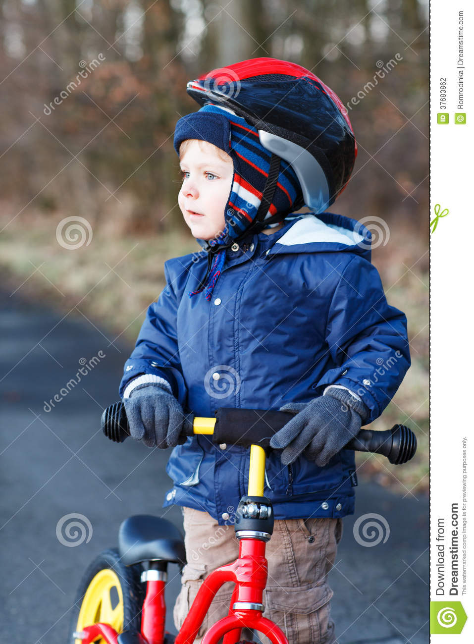 2 Years Old Toddler Riding On His First Bike Stock Photo Image Of