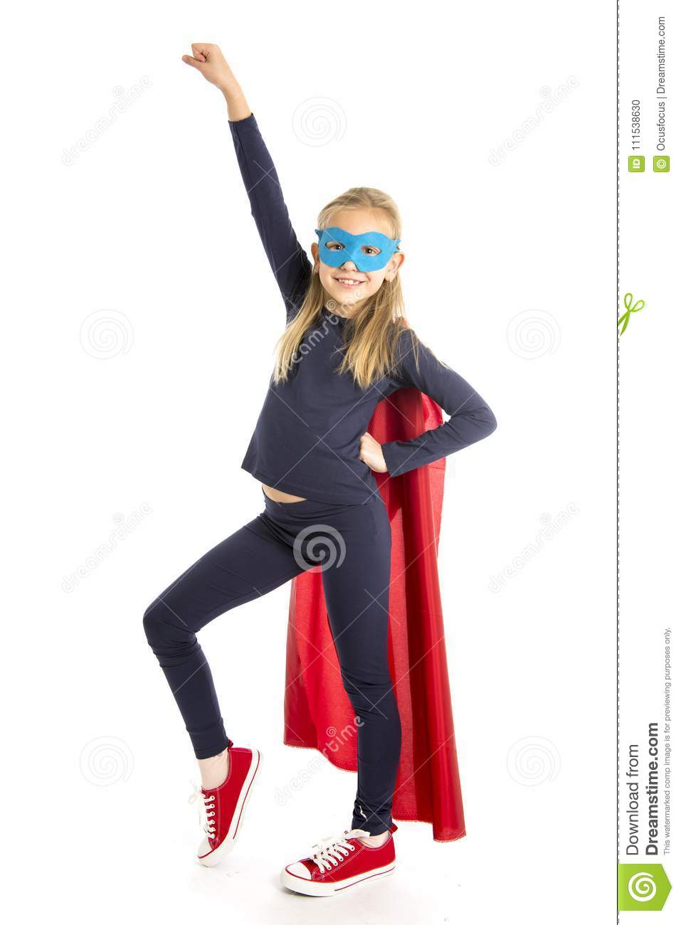 7 or 8 years old young female schoolgirl child in super hero costume performing happy and excited isolated on white background