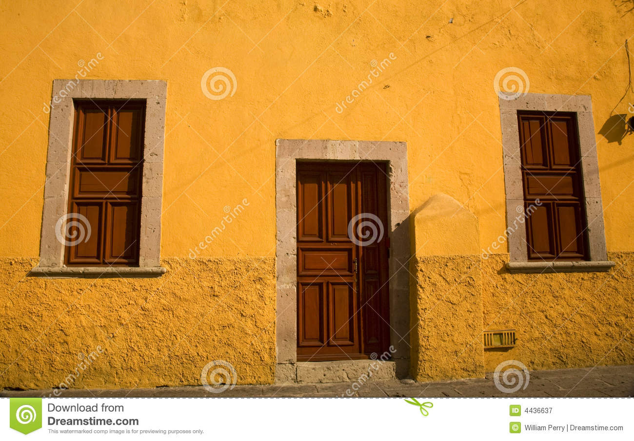Yellow Adobe House Brown Doors Morelia Mexico Stock Image