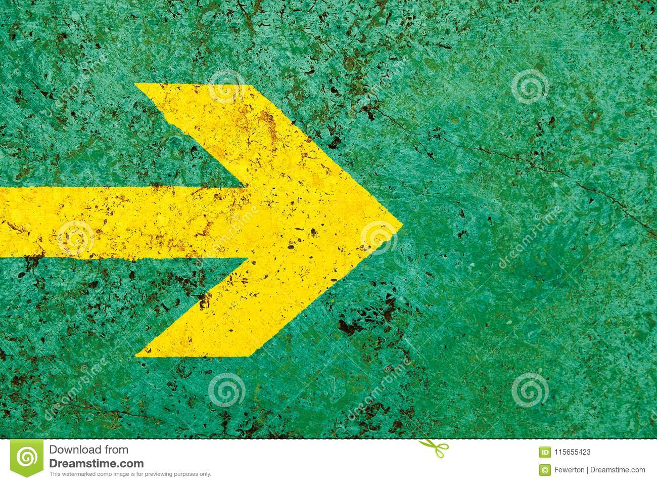 Yellow Arrow Direction Sign Over Vivid Bright Green Color Stone Wall ...