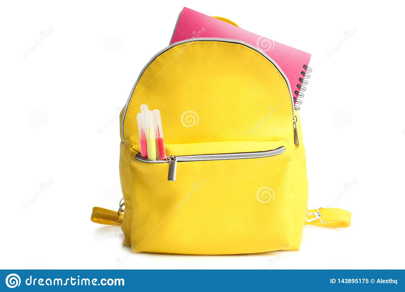 Yellow backpack with different school supplies
