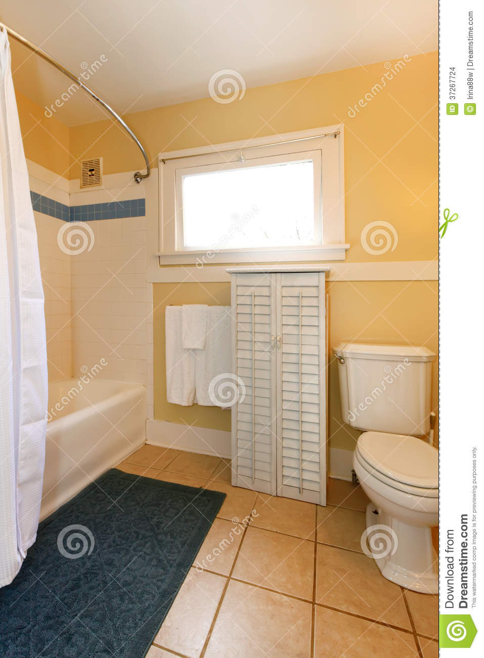 Yellow and beige cozy bathroom stock photo image of - Small white bathroom cabinet floor ...