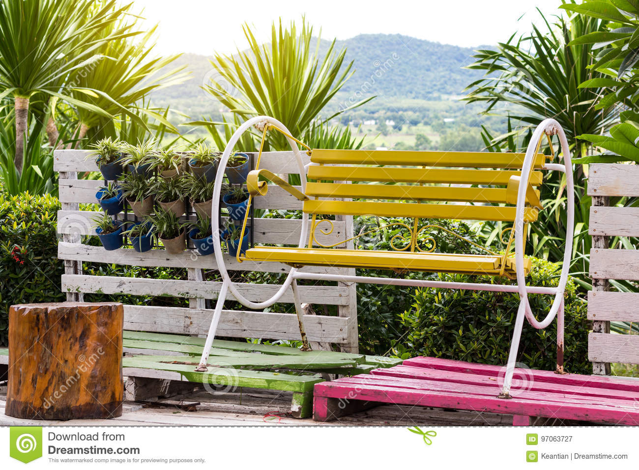 Excellent Yellow Bench Swing In The Garden Stock Image Image Of Camellatalisay Diy Chair Ideas Camellatalisaycom