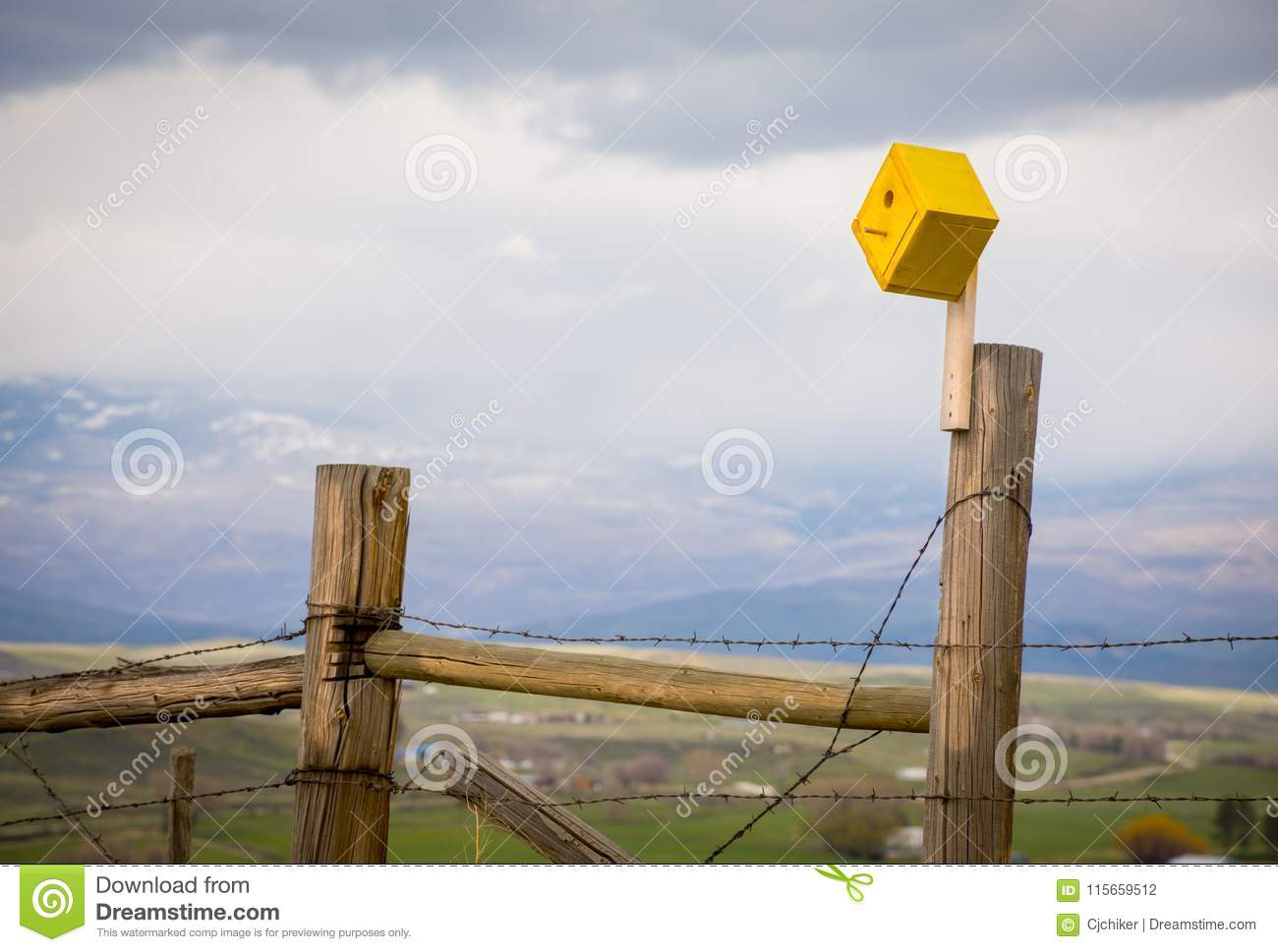 Yellow Birdhouse On A Barbed Wire Fence Stock Photo - Image of house ...