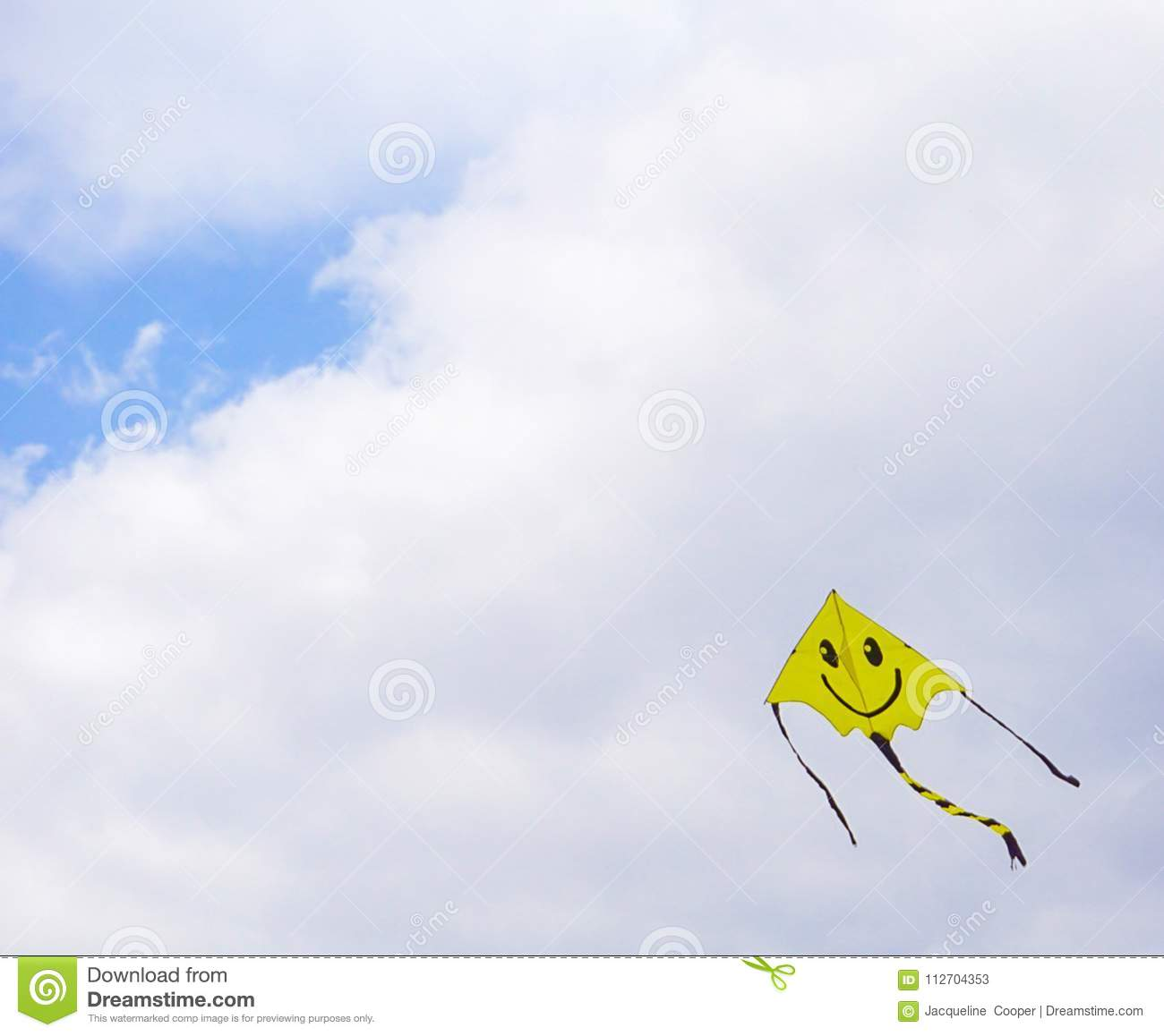 Smiley Face Kite Flying In A Cloudy Skiy Stock Image Image Of