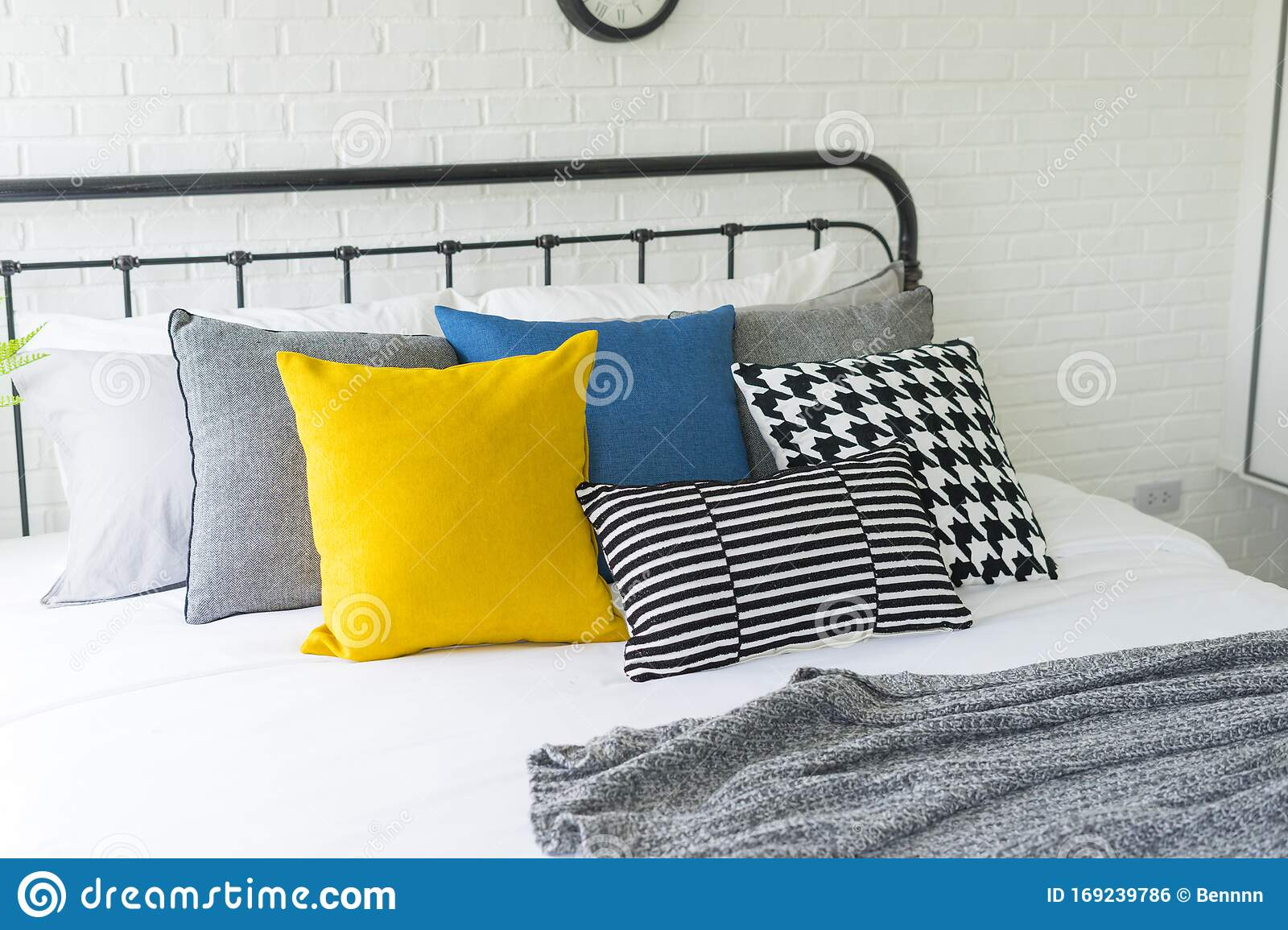 Yellow And Blue Pillows On Bed In Modern Bedroom Stock Photo Image Of Pattern Bedside 169239786