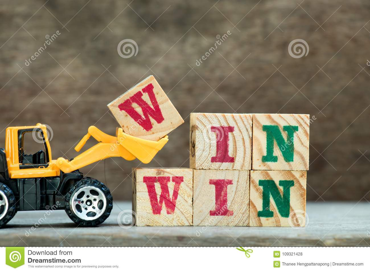 Yellow Bulldozer Hold Letter Block W To Word Win Win Stock Photo