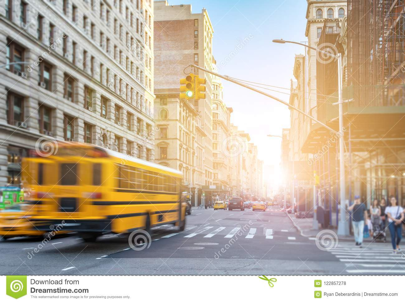 8612decd50a09 Yellow Bus Driving Fast Down Fifth Avenue In Manhattan New York City ...