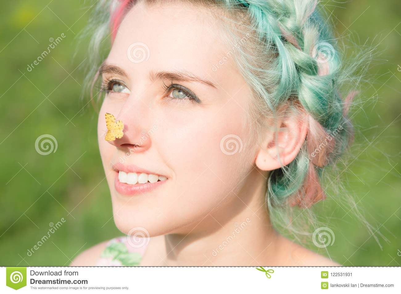 yellow butterfly sitting on the nose cute young girl on nature