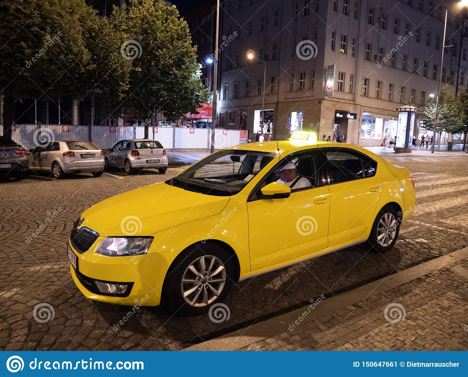 Yellow Cab Or Taxi On Wenceslas Square At Night In Prague Stock