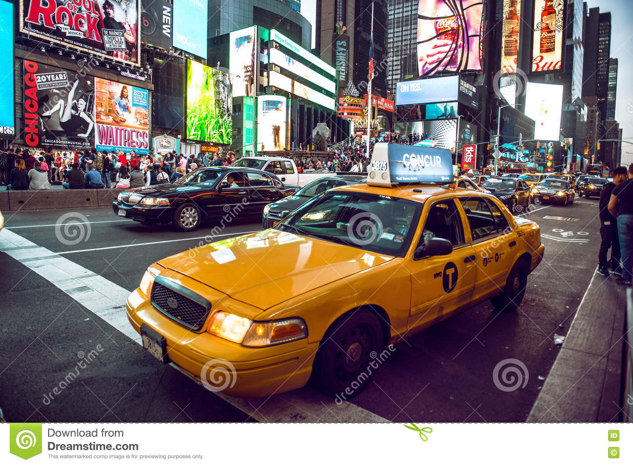 Yellow cab on Times Square traffic and animated LED signs, is a symbol of New York City and the United States, May 12, 2016