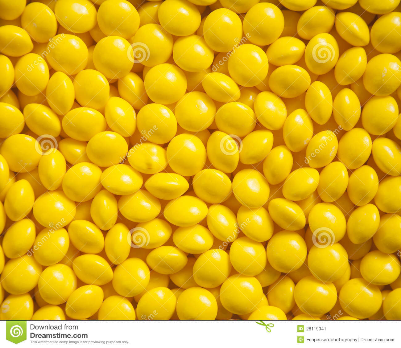 Bright yellow candies for a textured background.
