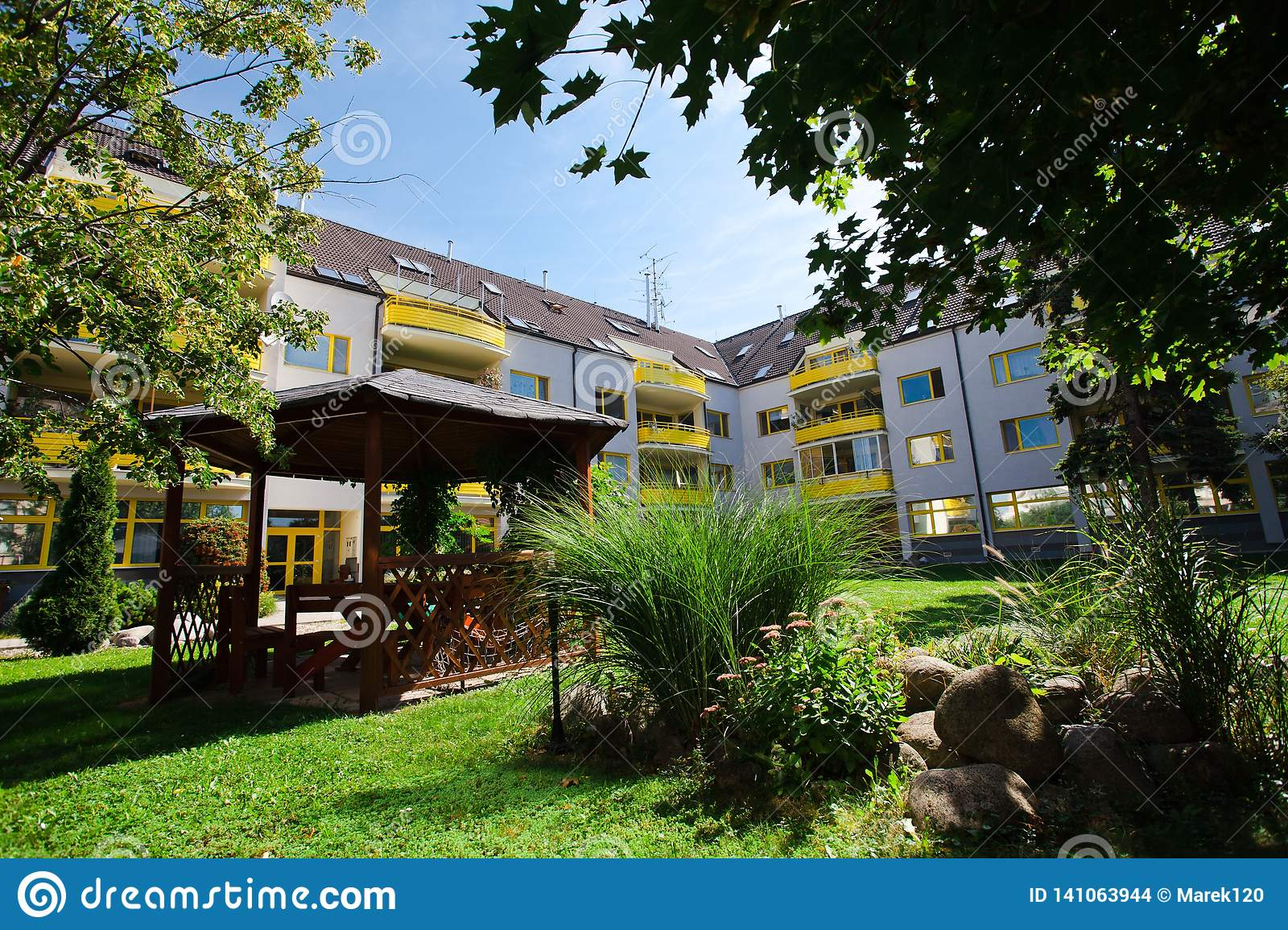 Yellow complex of residential house - Block of flats - Park in backyard