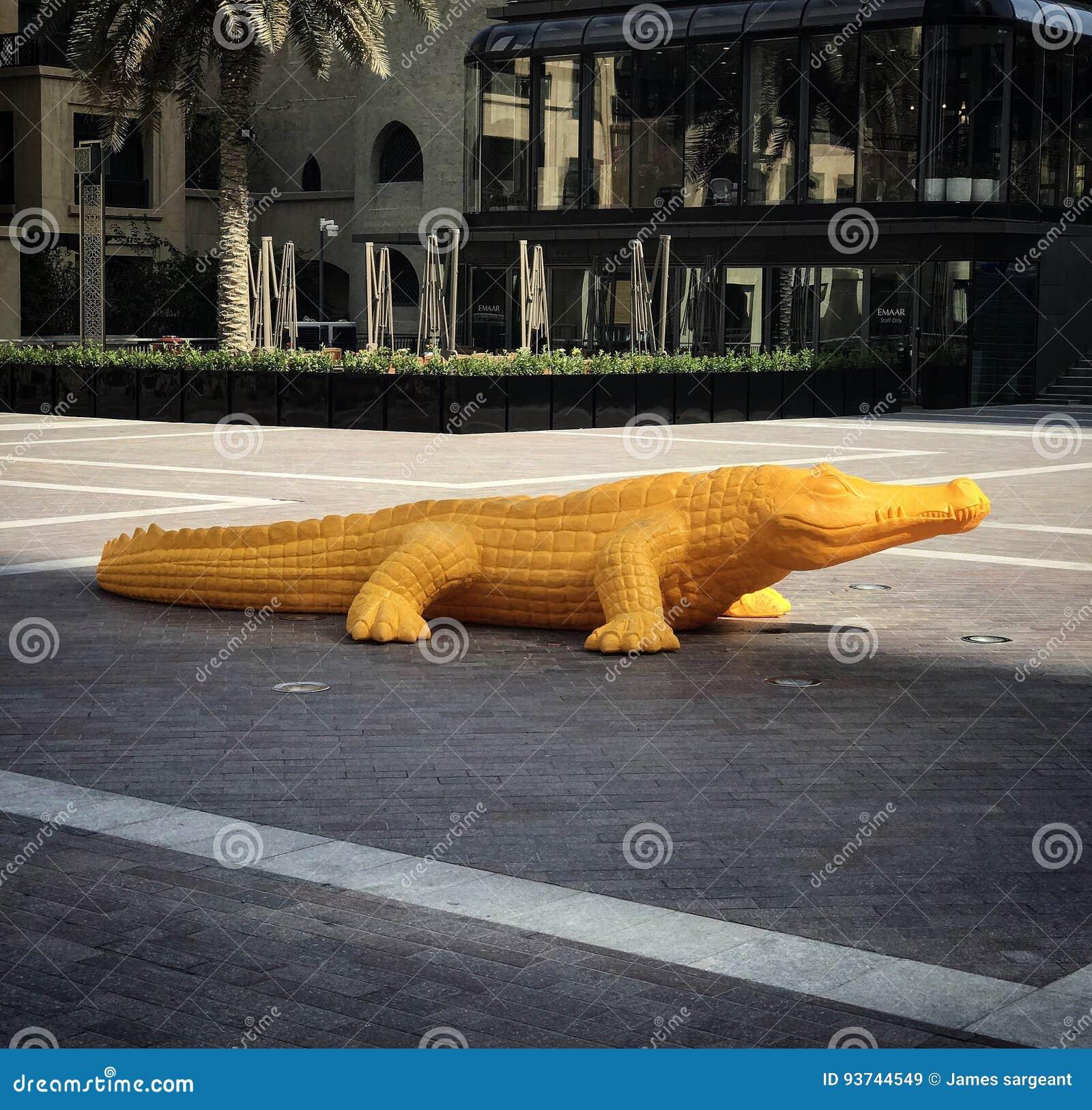 Yellow crocodile editorial stock image  Image of urban