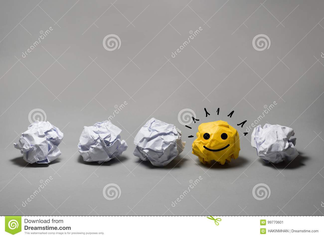 Yellow crumpled paper ball.Business creativity,leadership concept