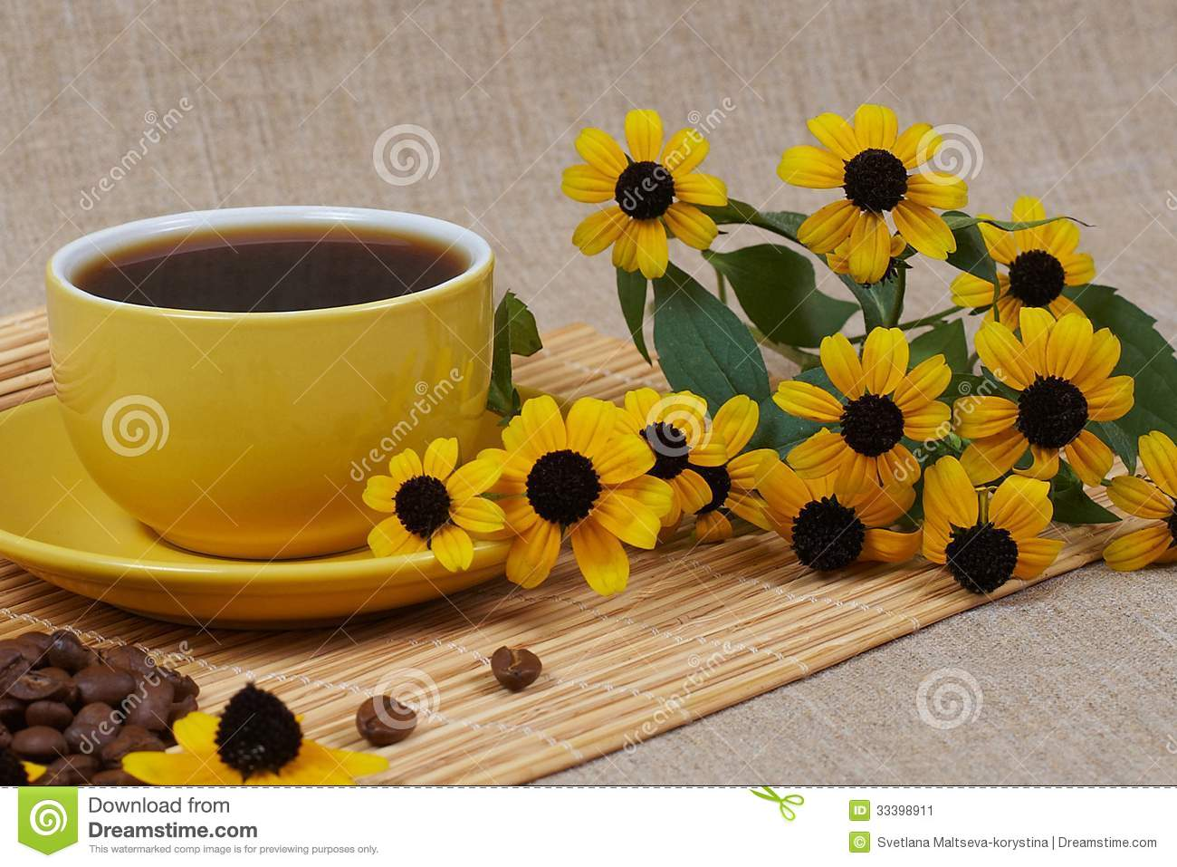 Yellow Cup Of Coffee With Flowers Stock Image