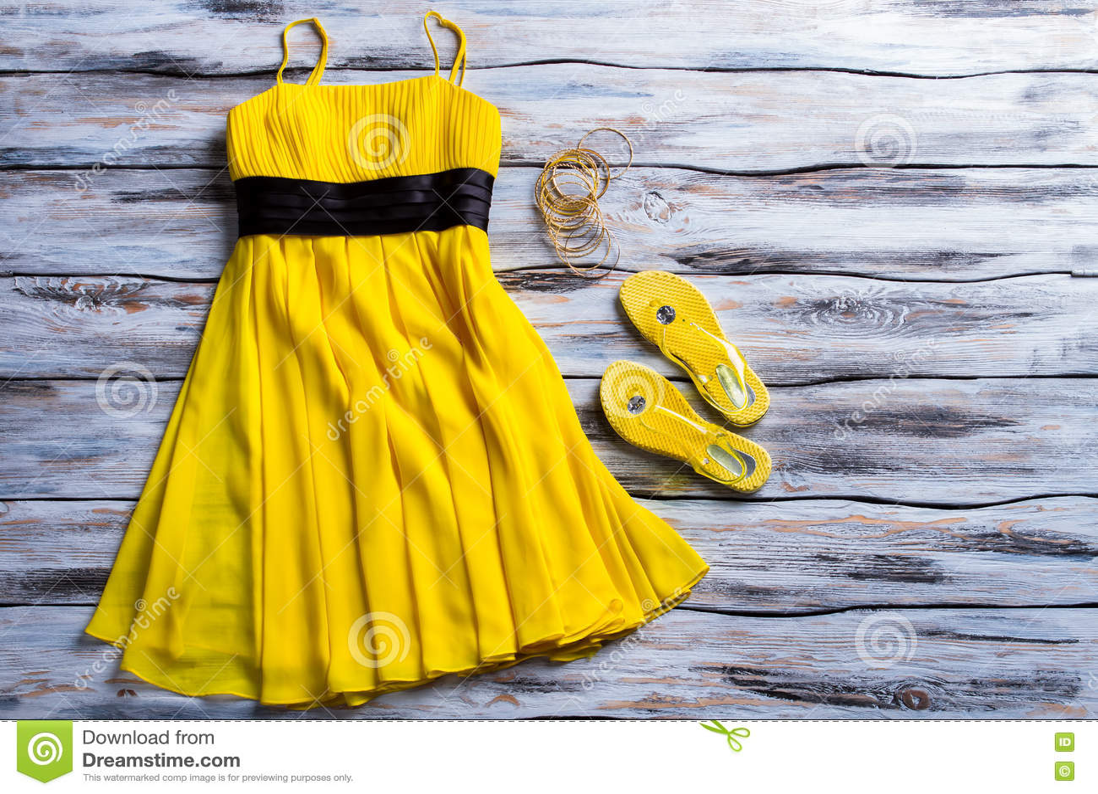 Yellow dress and flip flops.