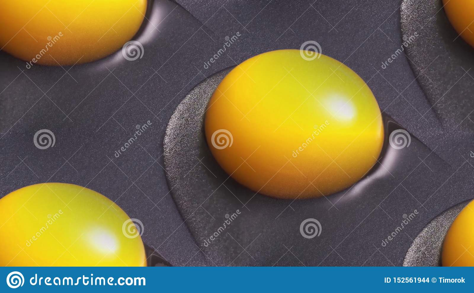 Yellow egg yolks are cooked in a skillet