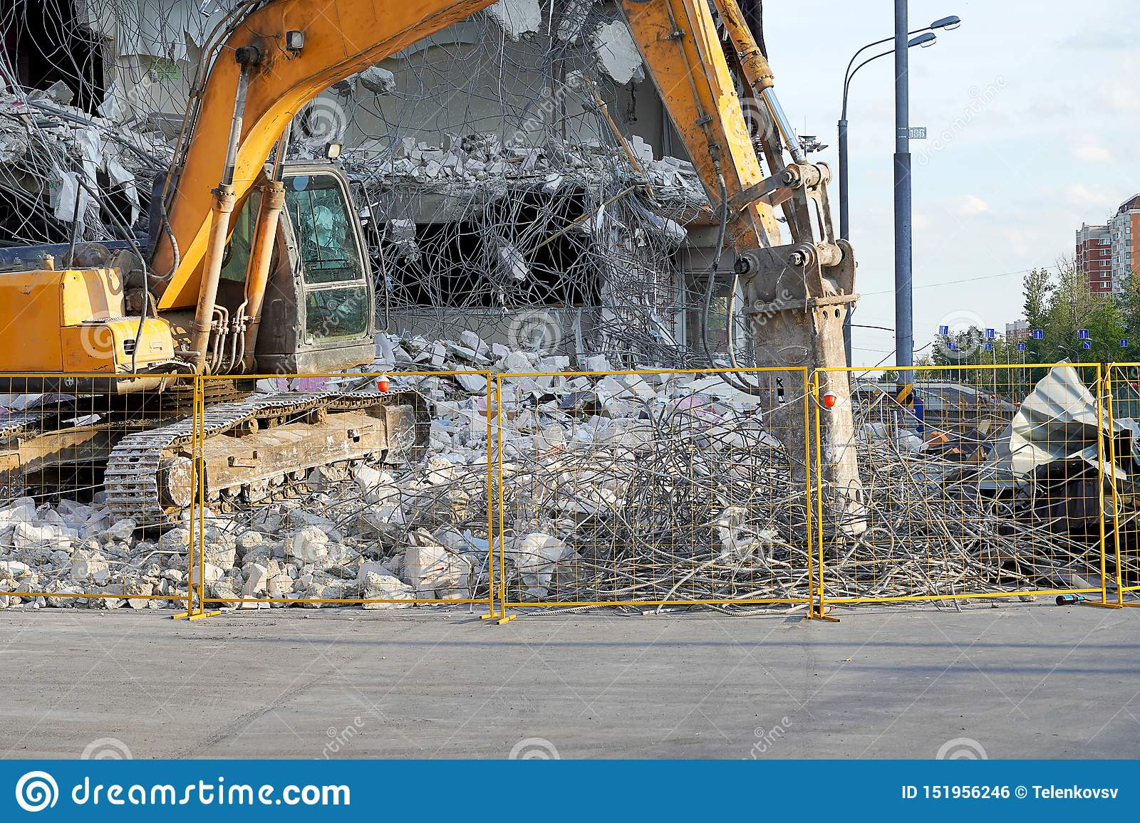Yellow Excavator Destroyed A Multi-storey Building With A