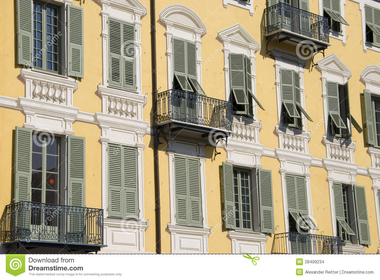 Yellow facade building with fake stucco nice stock photo for Stucco facade