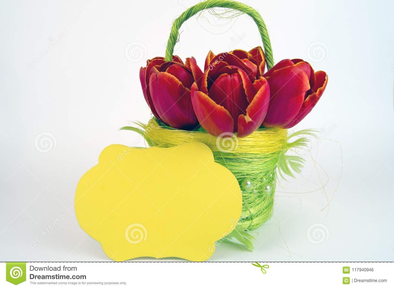Yellow flower basket with red tulips