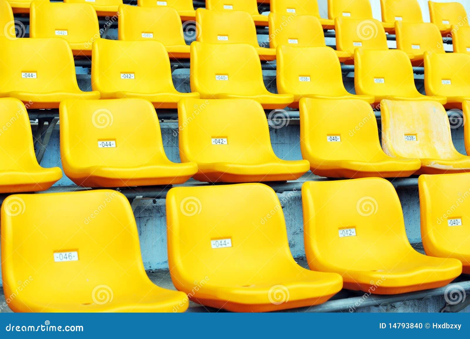 yellow football seats stock photo