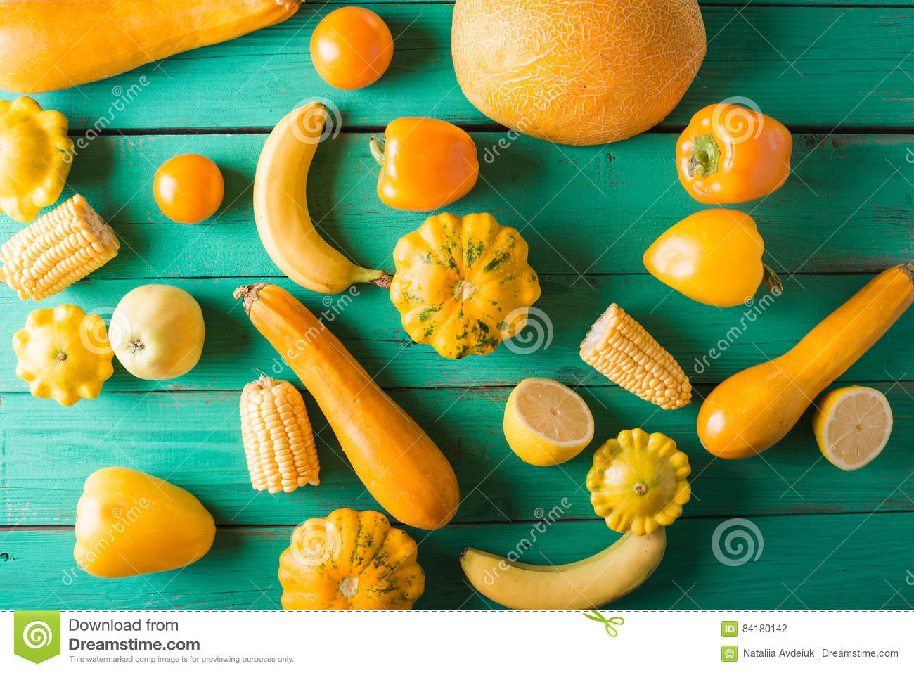 Yellow Fruits And Vegetables On A Turquoise Wooden ...