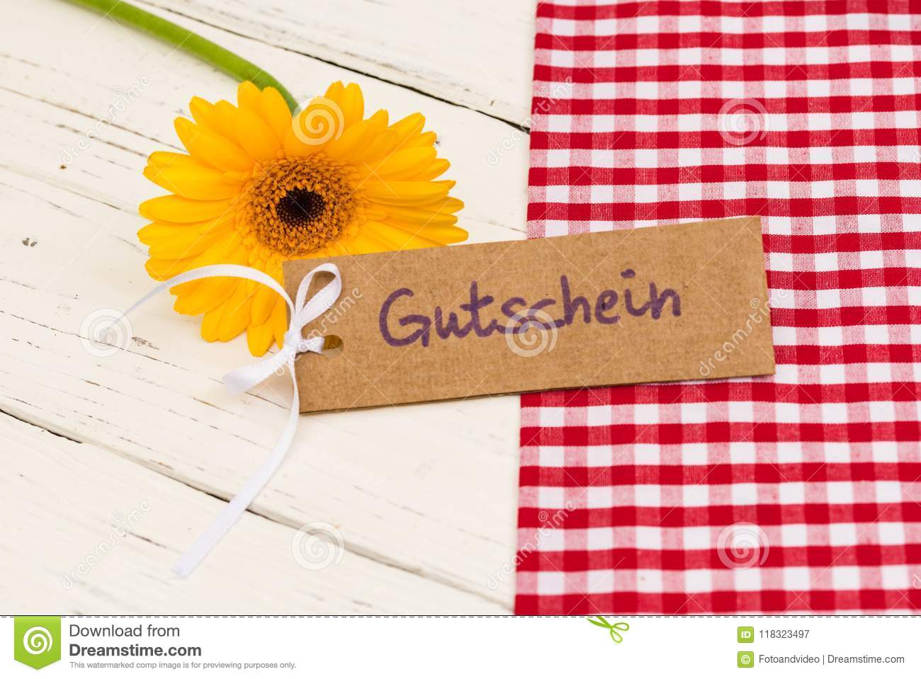 Yellow flower with gift tag german word gutschein means voucher or yellow flower with gift tag german word gutschein means voucher or coupon mightylinksfo