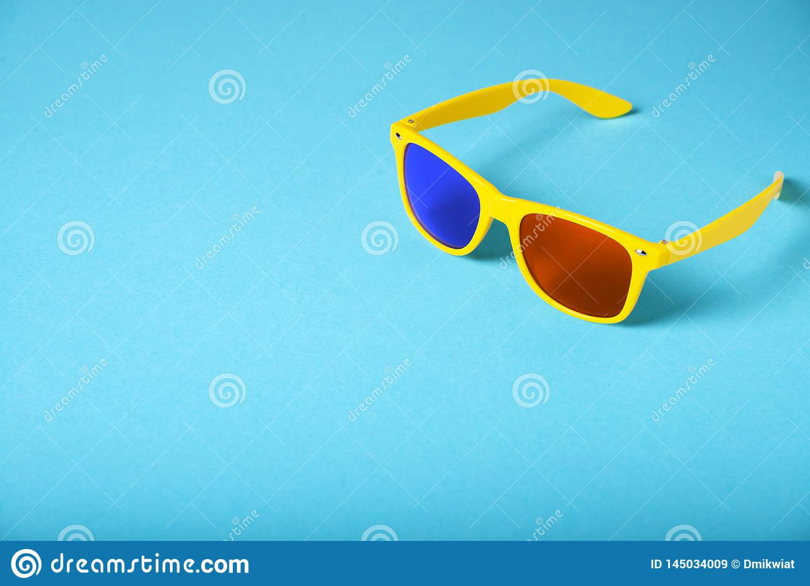 Yellow glasses isolated on blue background. 3D glasses