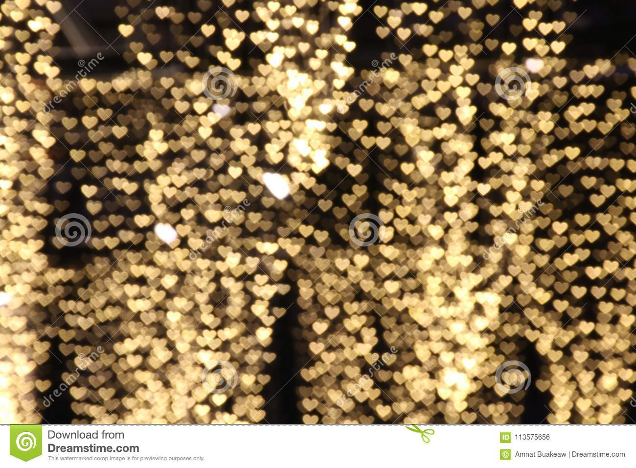 Yellow gold heart-shaped hanging valentine background Colorful lighting bokeh white for decoration night backdrop wallpaper