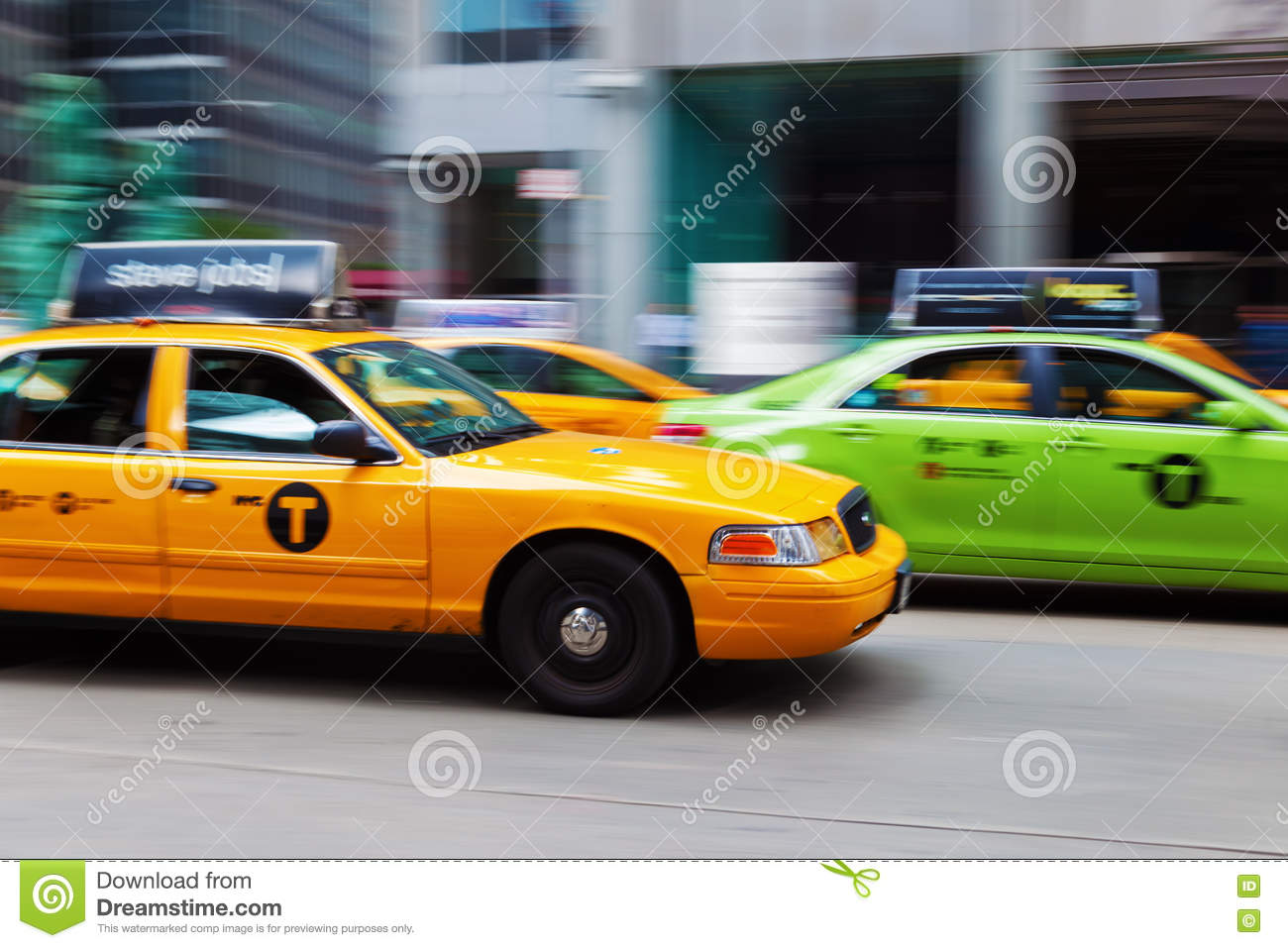 Yellow And Green Cab In NYC In Motion Blur Editorial Stock
