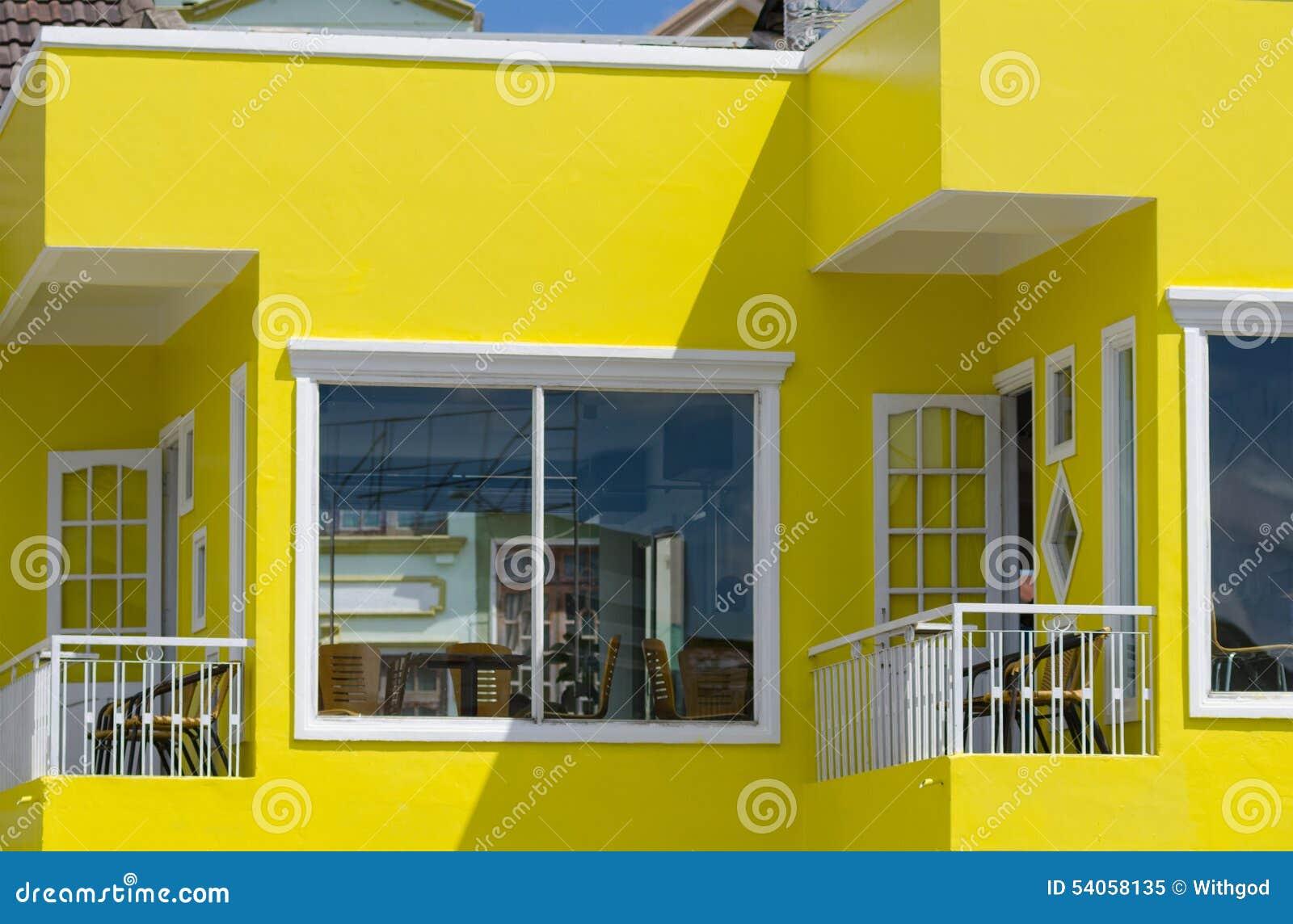 Yellow house with balconies stock image image of for Casas pintadas por dentro