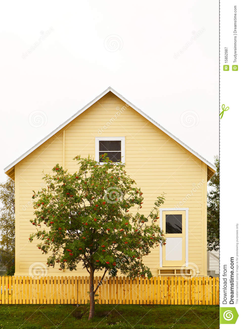 Yellow house and fence with red and green tree royalty - Yellow house with green roof ...