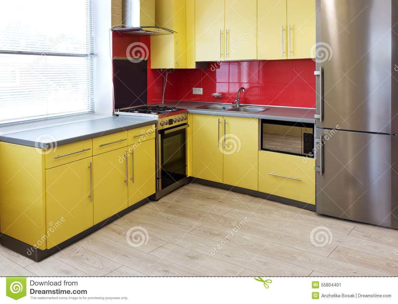 yellow kitchen with cupboards with hinged doors topped with a grey