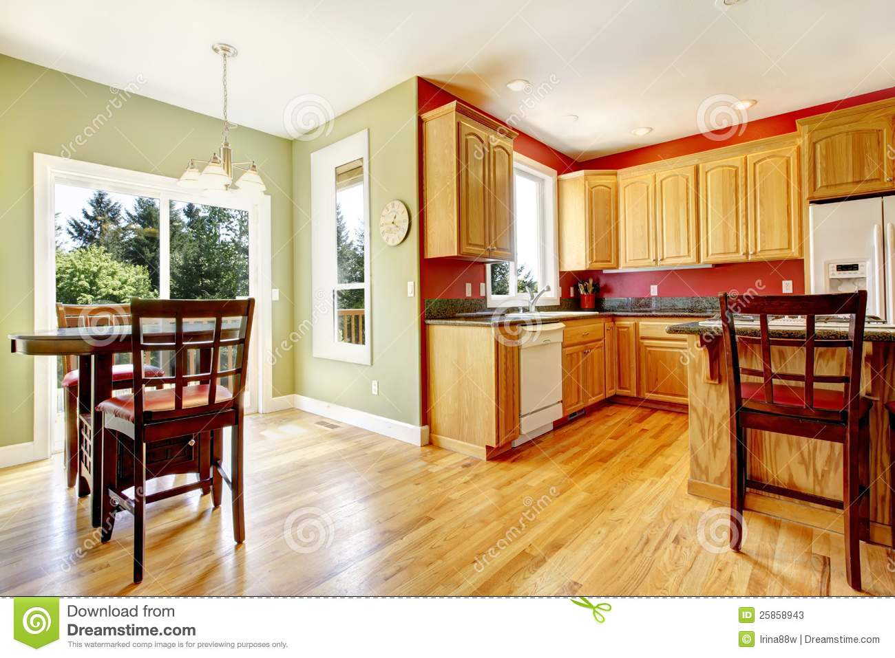 Yellow Kitchen With Wood And Red And Green Colors Stock