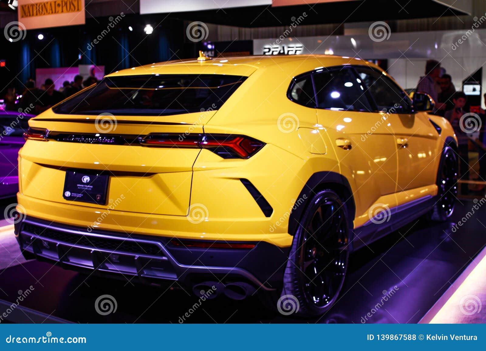 Yellow Lamborghini Family On Display As Well As A Black Bentley