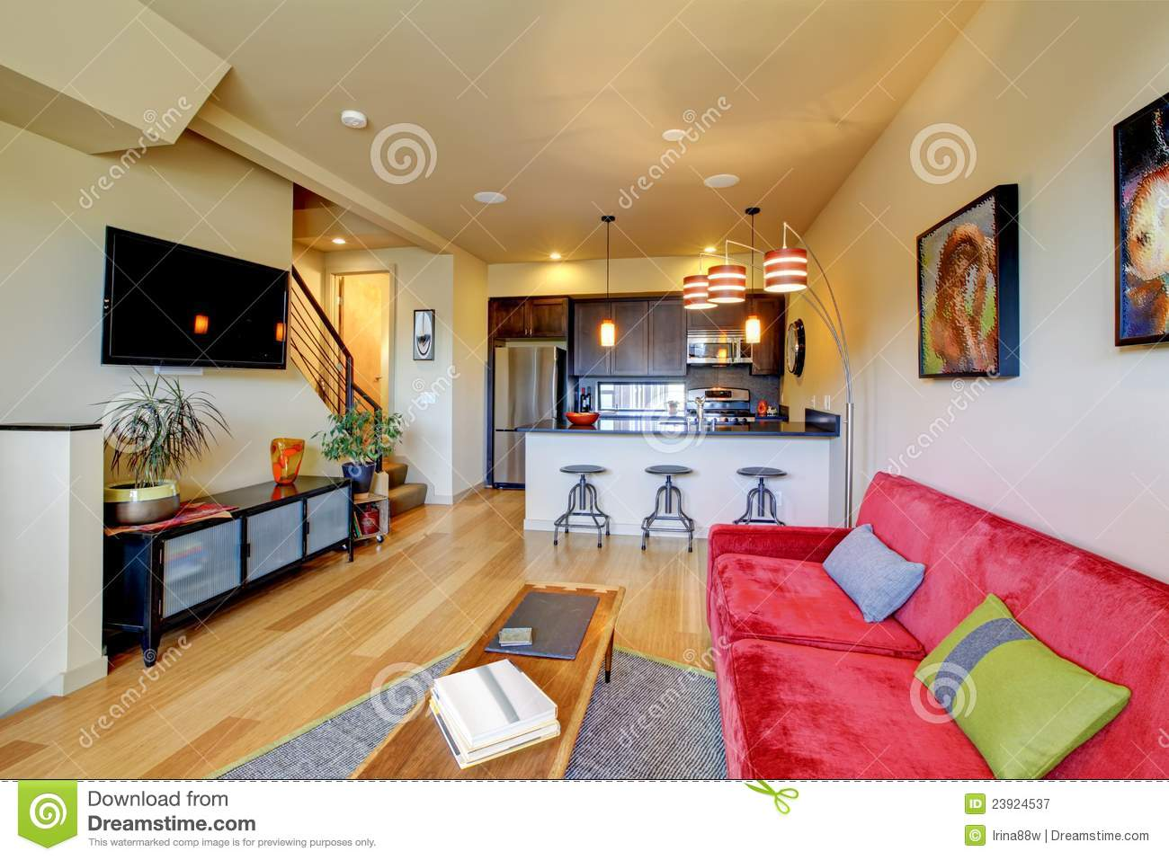 Yellow Living Room Ith Red Sofa And Kitchen Royalty Free