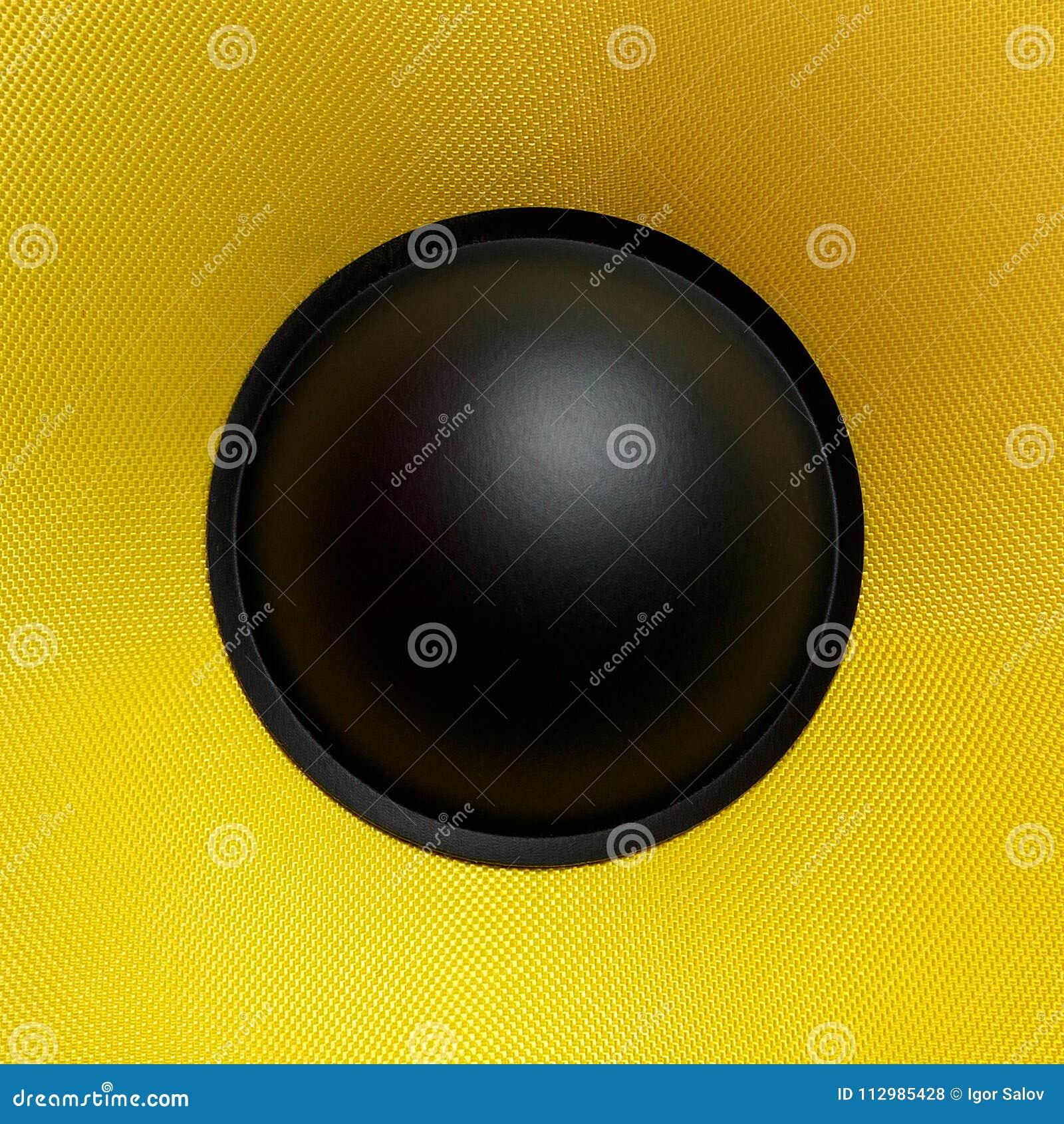 Yellow speaker loudspeaker close-up part of a musical column
