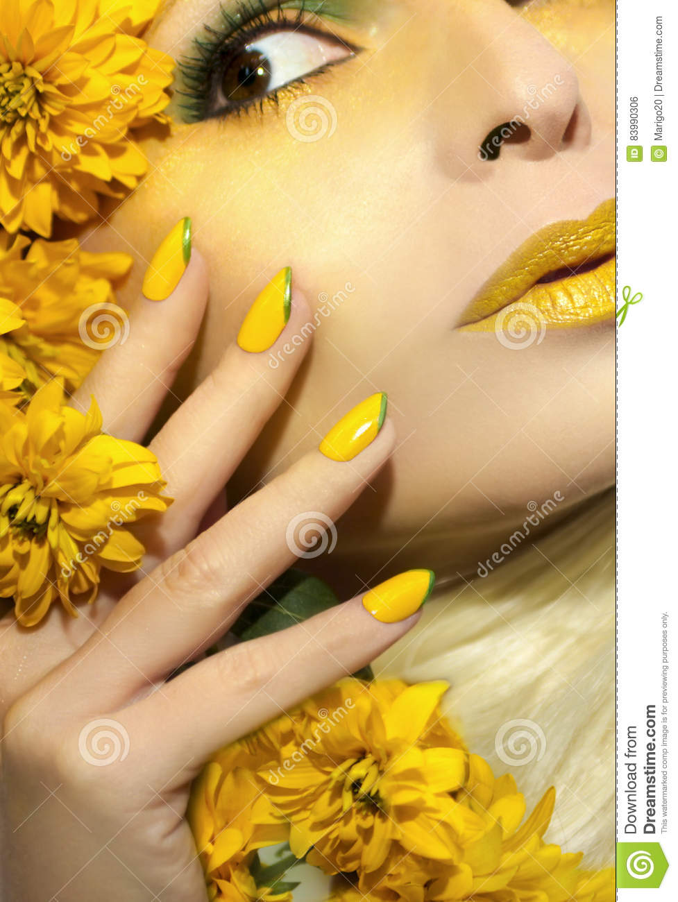 Yellow makeup and manicure.