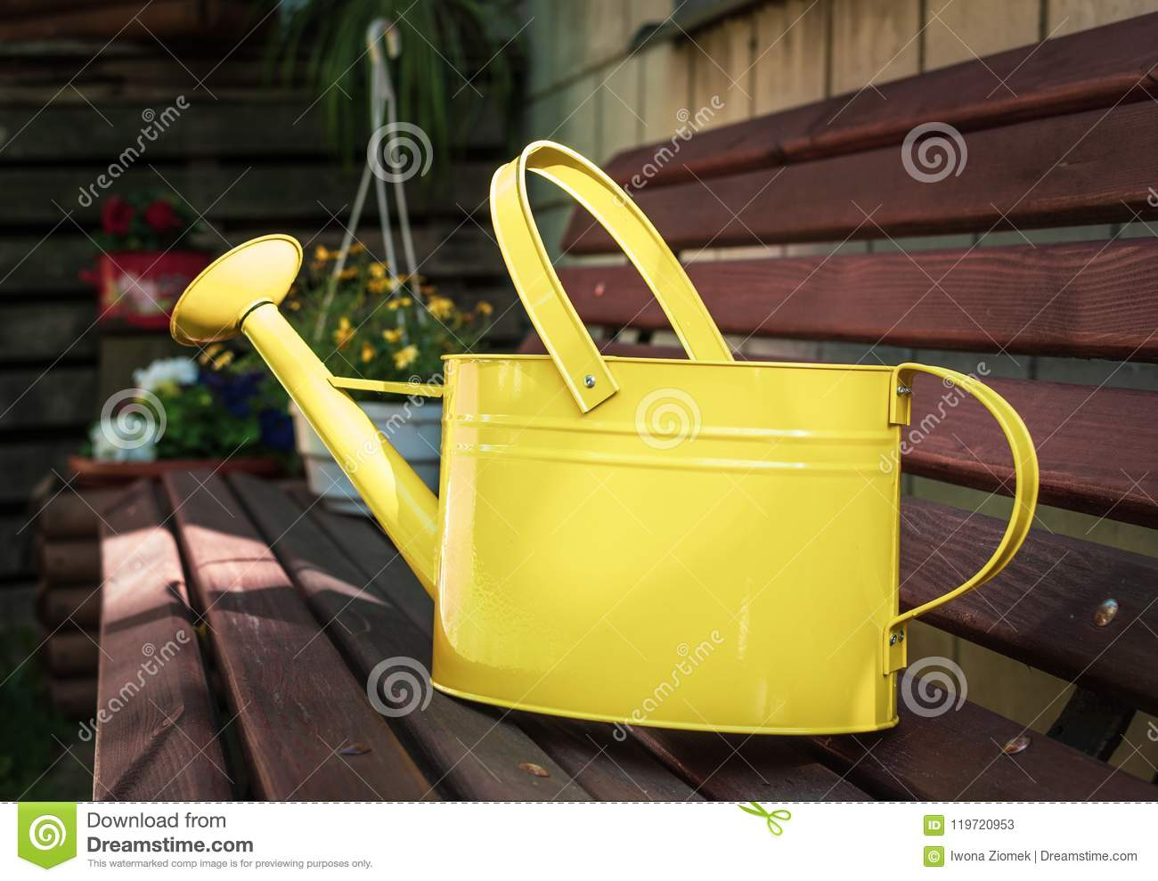 Strange Yellow Metal Watering Can On A Wooden Garden Bench Stock Creativecarmelina Interior Chair Design Creativecarmelinacom