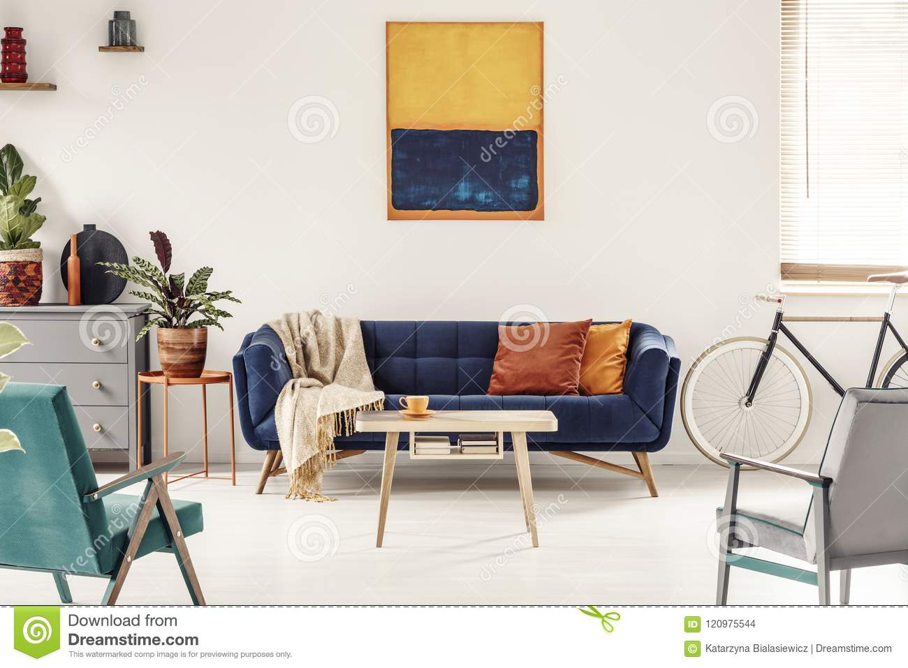 Yellow And Navy Blue Painting Above Sofa In Colorful Living
